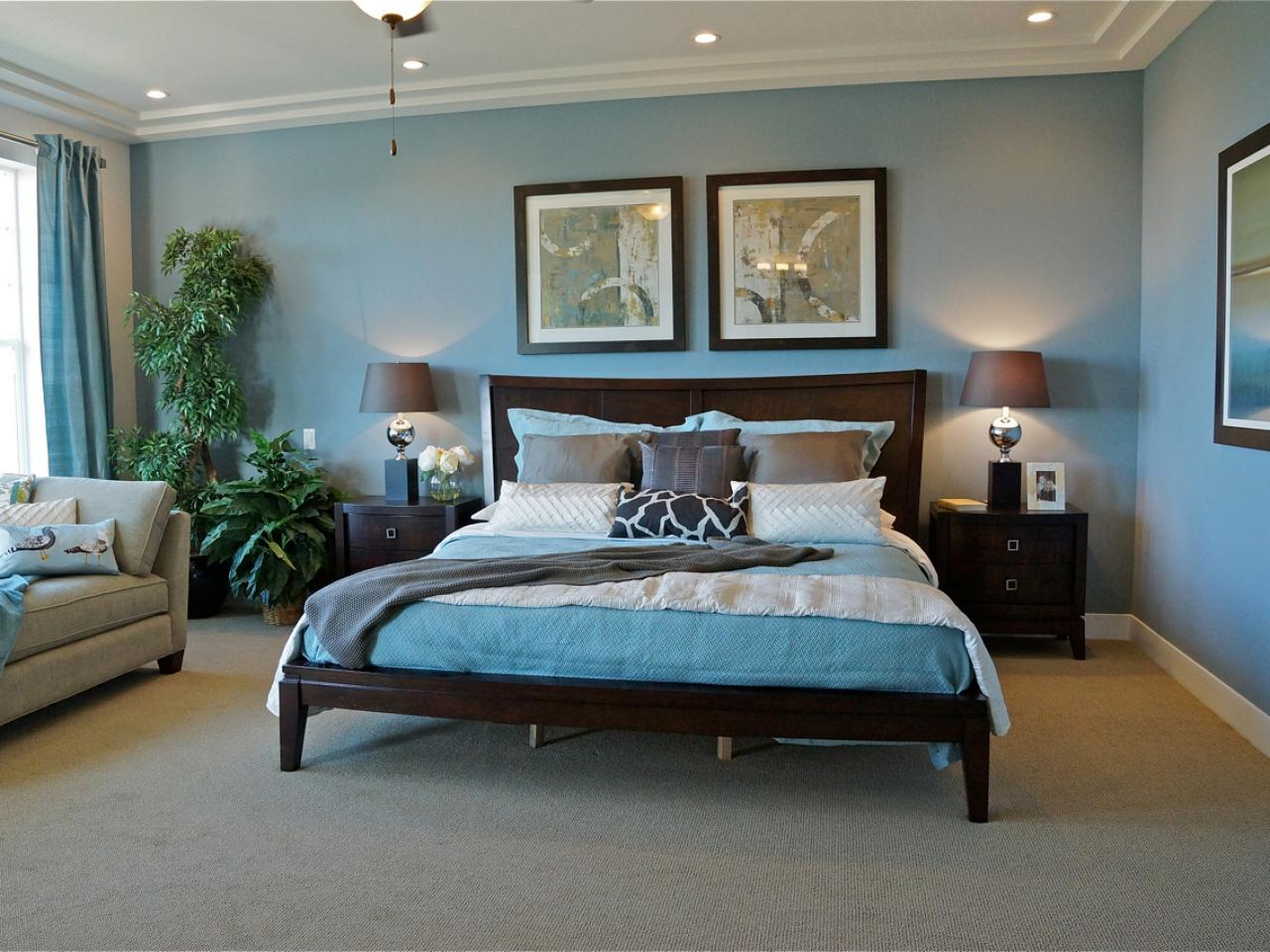 Traditional blue bedroom with dark wood furniture and for Bedroom decor chairs